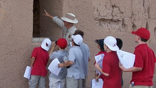 volunteer ranger leading group of children on tour