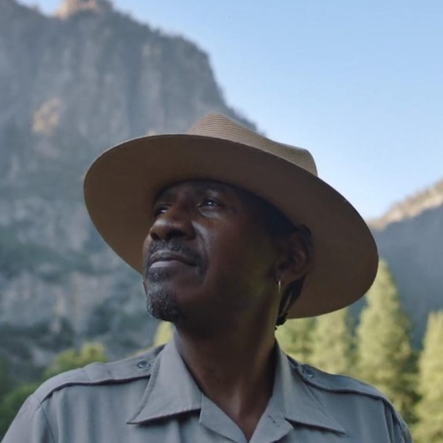 Park Ranger with Mountains in the Background