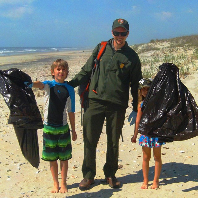 Ranger leading a beach clean-up program