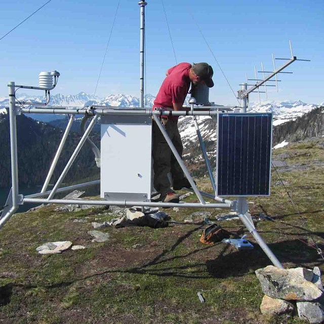 A researcher maintaining a weather station.