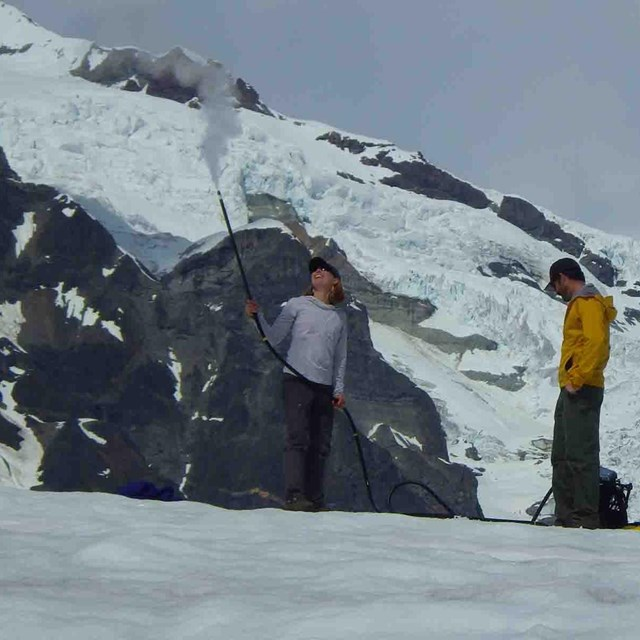 Researchers measure the mass of a glacier.