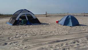 Tents on the sand.