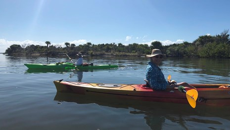 Volunteers at a kayak paddle.