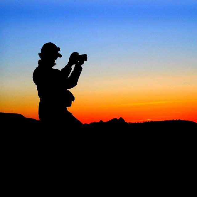 Silhouette of photographer after sunset.
