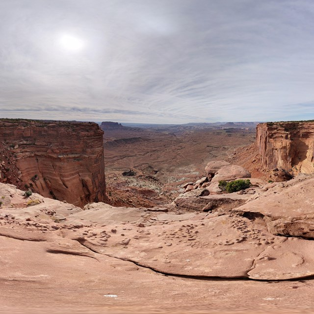 a panorama view of canyons and cliff walls