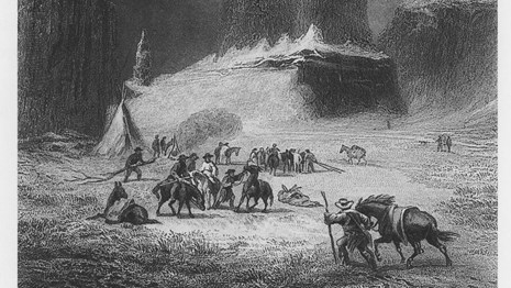 Black and white engraving of men, animals, and two large rock pillars.
