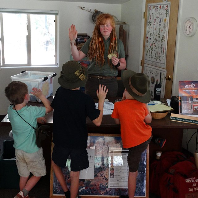 Volunteer saying Junior Ranger pledge with three children and an adult.