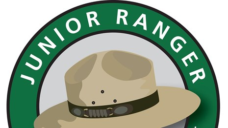Junior Ranger Logo with flat hat and text Explore, learn, protect