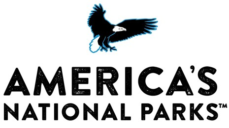 logo for America's National Parks with eagle flying over text