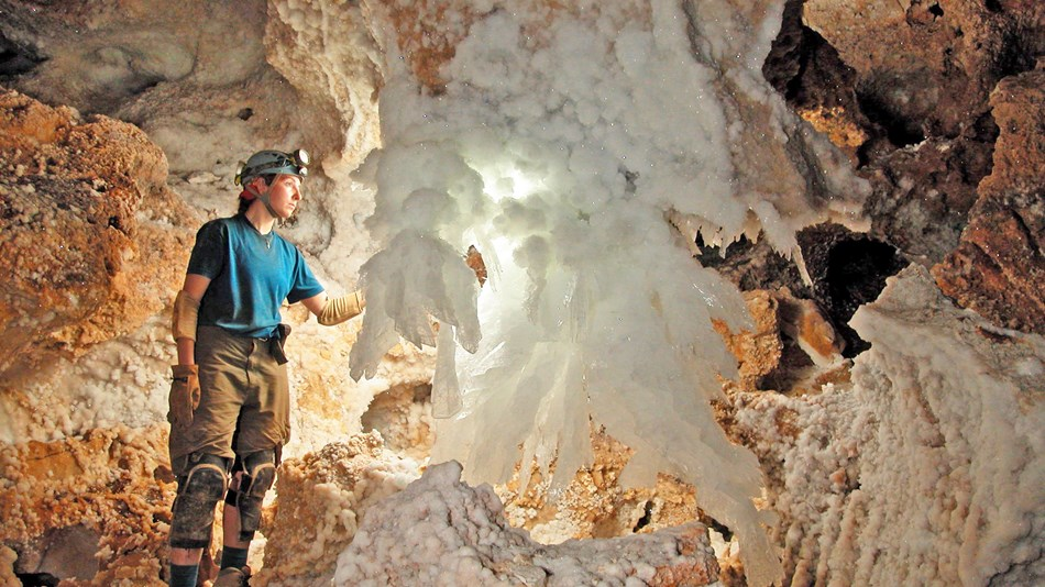 caver near large gypsum cave feature