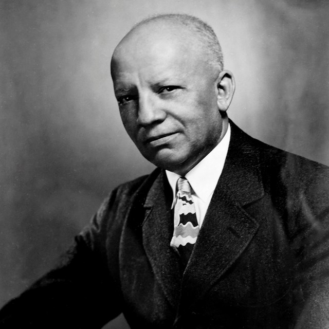 A black-and-white portrait of Carter G. Woodson