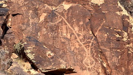 Petroglyphs on red rock