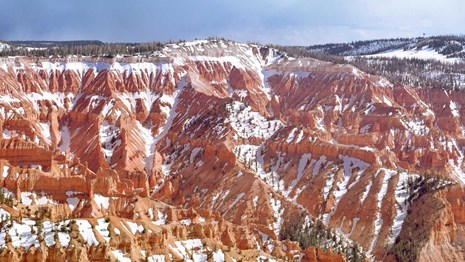 Red rock landscape with snow.