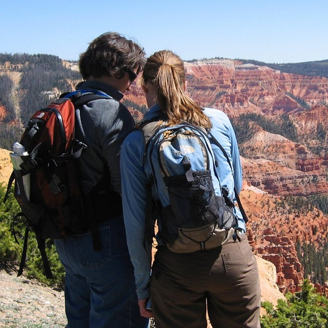 A couple overlooking Cedar Breaks National Monument.