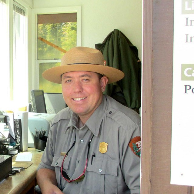 Male park ranger smiling.