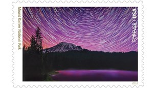 Stamp depicting night sky about Mount Rainier