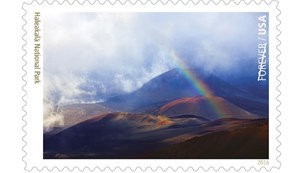 Rainbow over volcanic landscape