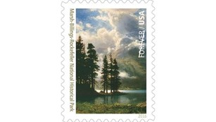 Stamp featuring a painting of Grand Tetons
