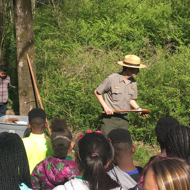 A ranger talks to a group of Students