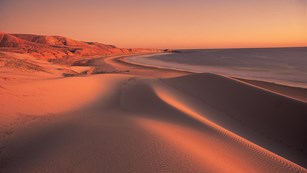 Sand dunes along coast at sunset. ©Tim Hauf, timhaufphotography.com