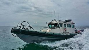 Ranger patrol boat going at high speed.