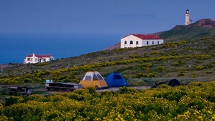 Campground with lighhouse on Anacapa Island. ©Tim Hauf, timhaufphotography.com