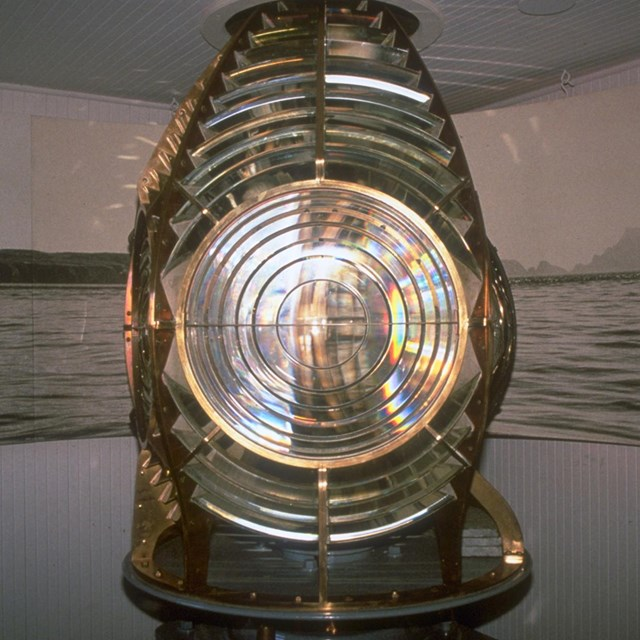 Closeup of glass and brass of fresnel lense.