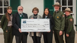 Rangers and partners present check