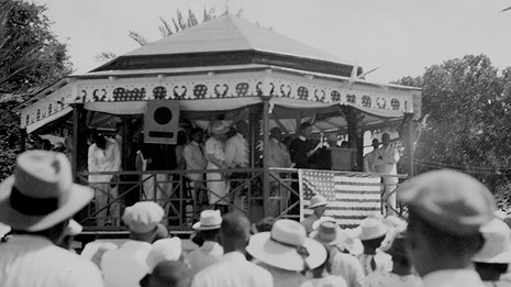 Black and white historic photo of a rally at the gazebo bandstand, 1940s