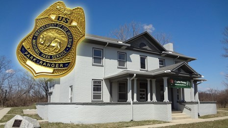 Park building and NPS law enforcement badge