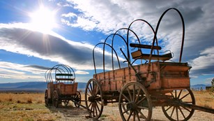 Two covered wagons.
