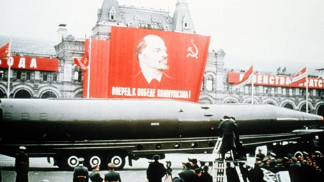 A Soviet SSN-8 intercontinental ballistic missile is displayed beneath a picture of Lenin