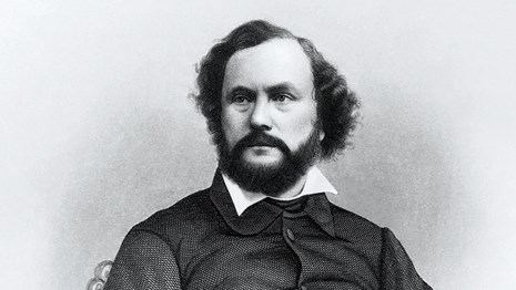 An engraving of Samuel Colt. Older man with beard.