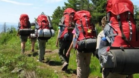 people backpacking on a trail