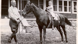 1936 photo of man and horse outside McGraw Ranch.