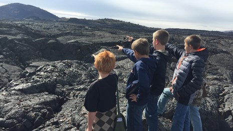 students on lava rock