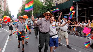 Park rangers and others march in a gay pride parade.