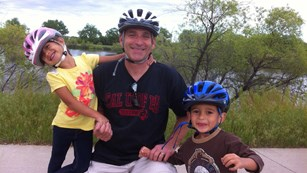 Dad with two kids on bikes