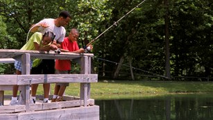 Family fishing on a dock