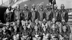 Black and white photo of uniformed airmen
