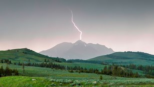 Lightning over a mountain and valley