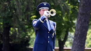 Military officer playing a bugle