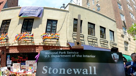 Stonewall National Monument banner in front of the Stonewall Inn
