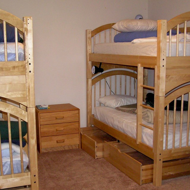 Bunkbeds with wooden frames.
