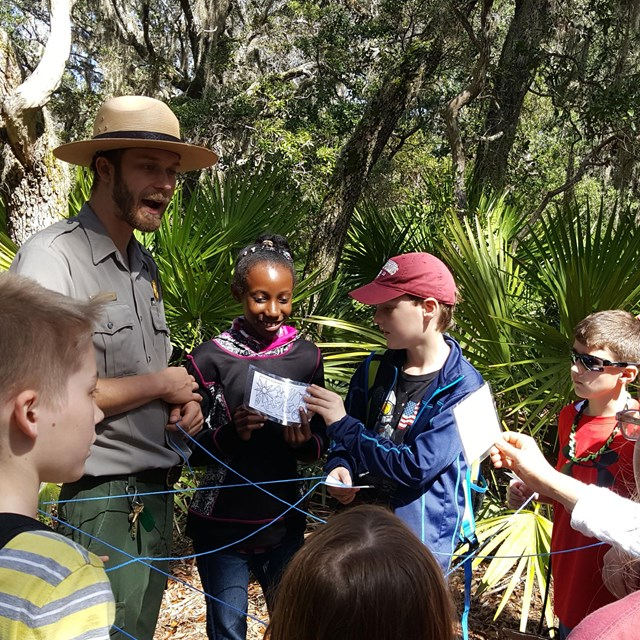 A ranger leads an educational activity