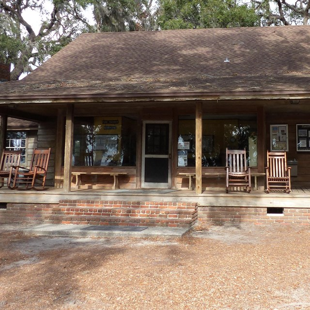 Wooden ranger station with large front porch and rocking chairs