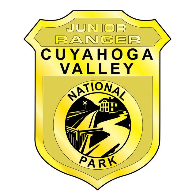 An illustration of the Cuyahoga Valley National Park Junior Ranger badge in the shape of a shield