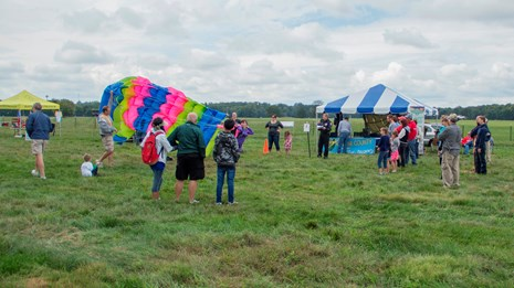 Visitors in a field during a park event