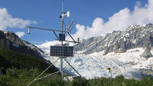 a climate station sits in front of a glacier