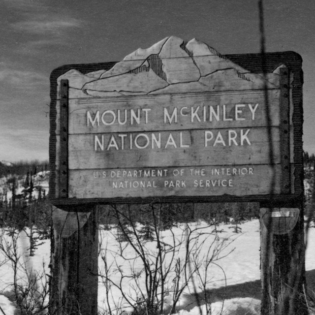a historic photo of the entrance sign for Mt. McKinley National Park